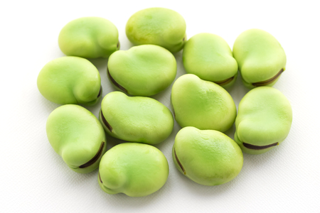 broad: raw broad beans isolated on white