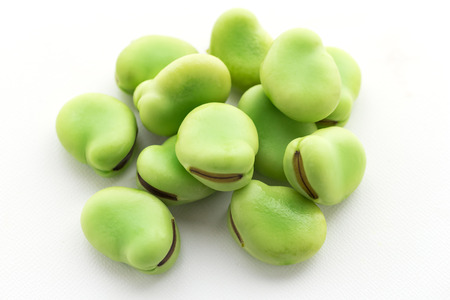 raw broad beans isolated on white