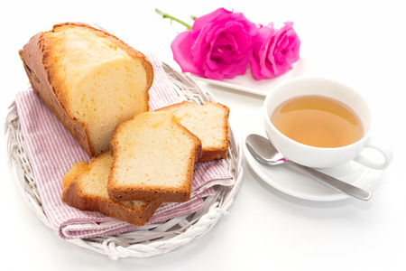 pound cake: Slices of pound cake on a bamboo tray.