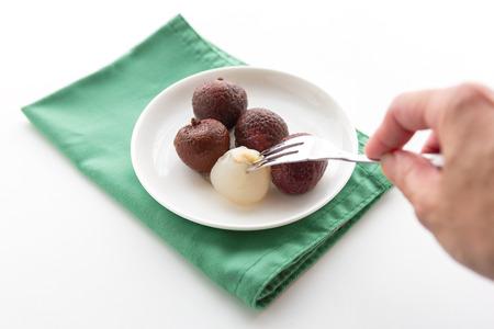 defrost: frozen lychee Stock Photo