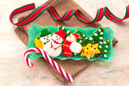 Delicious beautiful Christmas gingerbread cookies on wooden table