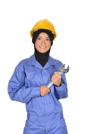 chrome vanadium: Muslimah woman holding big chrome vanadium spanner in the hand
