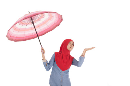 muslimah: Young muslimah holding an umbrella isolated on white