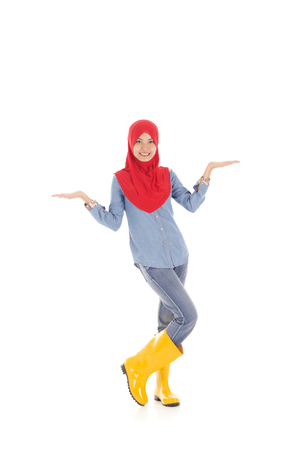 wellingtons: Young muslimah wearing yellow boot in pose