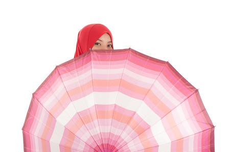muslimah: Young muslimah holding an umbrella