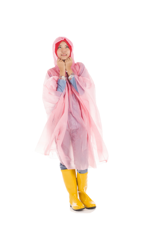 wellingtons: Young muslimah wearing pink raincoat and yellow boot isolated on white Stock Photo