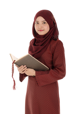 quran: Young muslim woman read Quran with rosary in the Ramadan time. Stock Photo