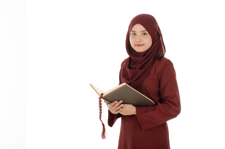 Young muslim woman read Quran with rosary in the Ramadan time. Stock Photo