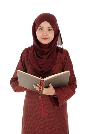Young muslim woman read Quran with rosary in the Ramadan time. 版權商用圖片
