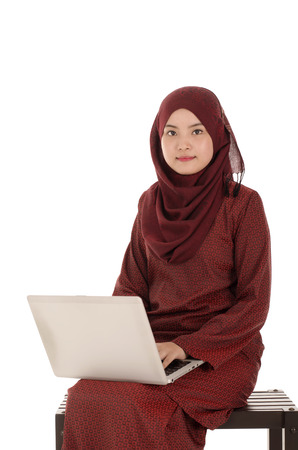 Beautiful muslim woman holding at laptop , isolated on white