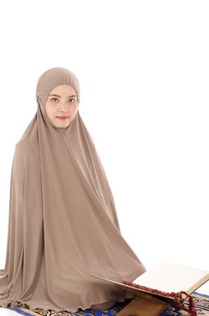 ksa: Portrait of a beautiful Muslim Arabic girl reading Al Quran