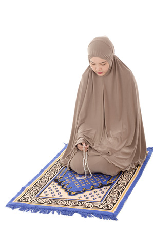 muslimah: Young beautiful muslimah holding tasbih on white background