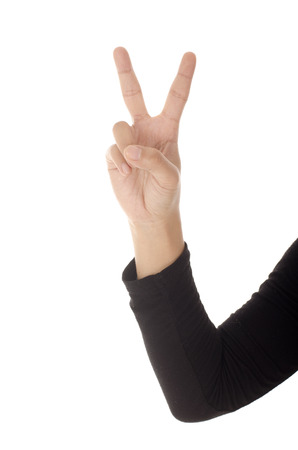 victory symbol: Hand with two fingers up in the peace or victory symbol. Isolated on white. Stock Photo