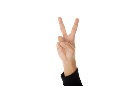 auction win: Hand with two fingers up in the peace or victory symbol. Isolated on white. Stock Photo