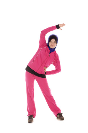 Young Fit Muslimah doing warm up stretching - isolated over white background 版權商用圖片