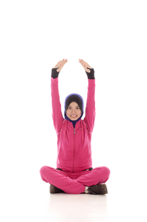 warm up: Young Fit Muslimah doing warm up stretching - isolated over white background Stock Photo