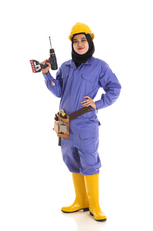 muslimah: A young female muslimah holding construction tools wearing a safety hat