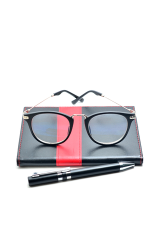 Business accessories on white background: diary, fountain pen, glasses. 版權商用圖片