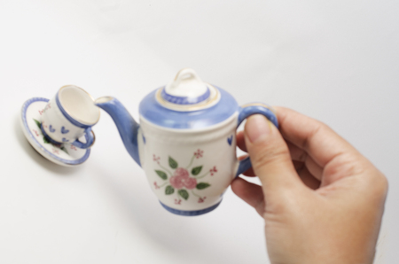 Soft focus and slightly blur orcelain teapot and teacup on white background