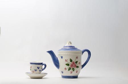 Porcelain teapot and teacup on white background 版權商用圖片