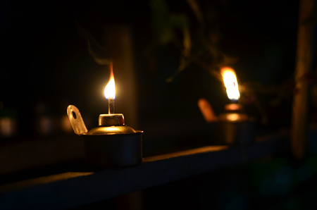 Traditional kerosene lamp light also known as pelita isolated in a dark background.