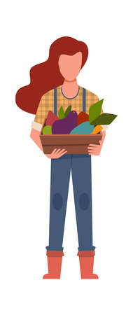 Woman gardener with harvest. Agricultural worker with bio vegetables