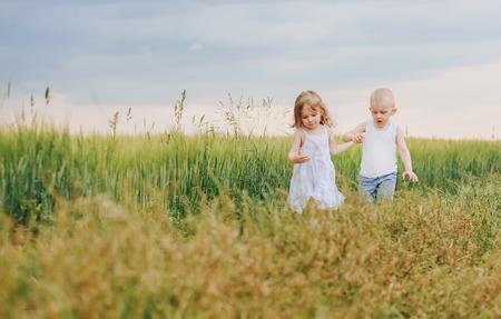 little children boy and girl running along the way