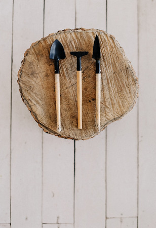 tool for decorating flowers on a wooden hemp