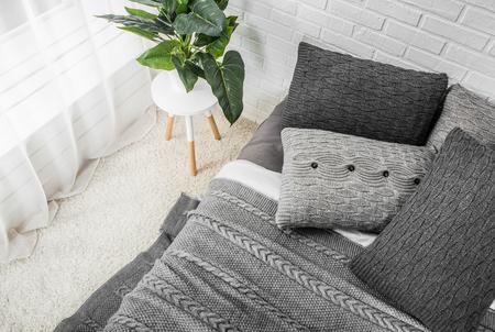 bedroom interior bed in gray tones with flower on bedside table and dekor 版權商用圖片