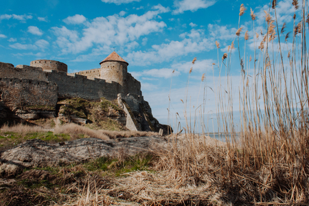 old fortress with a tower and stone walls in Europe on the seashore 写真素材 - 101728942