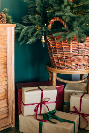 Rustic room decoration for Christmas parties with gift boxes and pine needles green brown beige