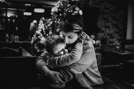 family couple child love happy in a cafe on holiday christmas evening Фото со стока