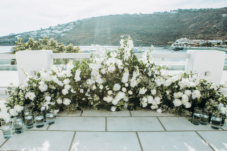 flower decoration area for the wedding at the pier by the sea Stok Fotoğraf