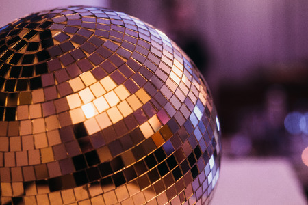 Mirror ball at a holiday party in a club with the reflection of light Banco de Imagens