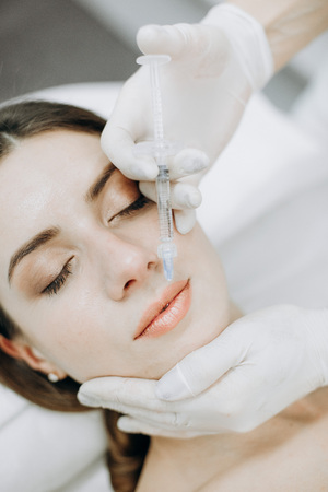 girl with perfect skin on the procedure in the office of cosmetology