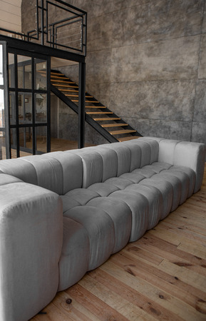 interior design in loft style metal and wood staircase and sofa