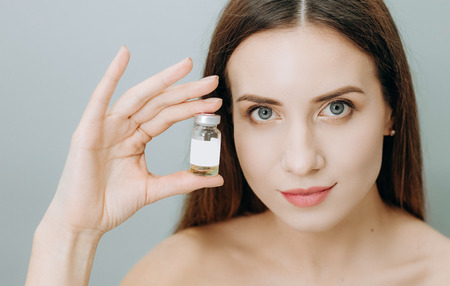 woman with beautiful skin advertises the drug the drug in the bottle says the best Stok Fotoğraf