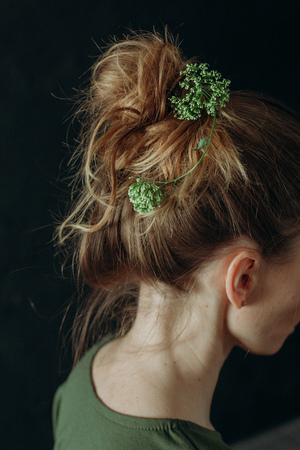 female hairstyle brunette girl with flowers and plants green and white