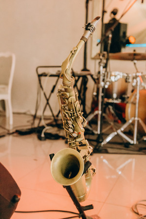 musical instrument trumpet saxophone on the stage in the center