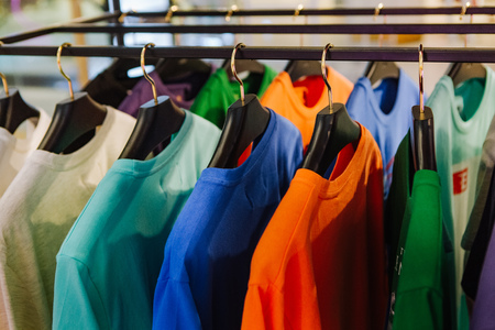 fashion boutique clothes showcase stand with a variety of color cardigans