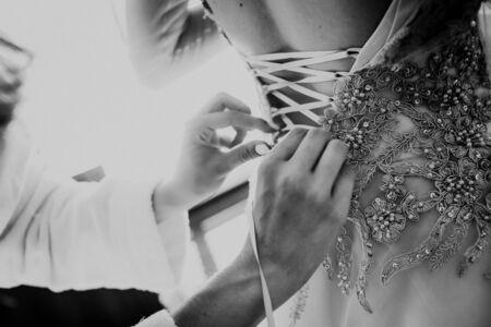 bride dress charges corset tie help hands girlfriend
