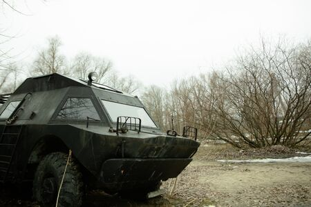 military armored car in the field spring mud rainy season