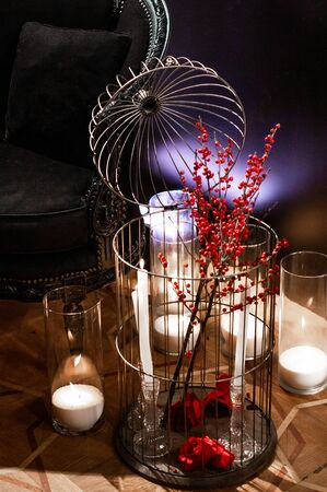 interior festive table evening dinner by candlelight with red lighting