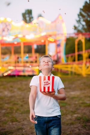 popcorn fireworks joy and emotions child outside festival fair with colorful background