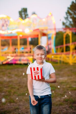 popcorn fireworks joy and emotions child outside festival fair with colorful background Фото со стока - 131975858