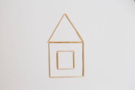 house drawn on a sheet of paper simplicity concept symbol family Фото со стока