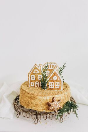 cake dessert festive christmas honey with gingerbread house figure isolated on white background