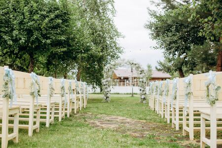 wedding decor flowers postcard chairs ceremony arch terrace party guests outside