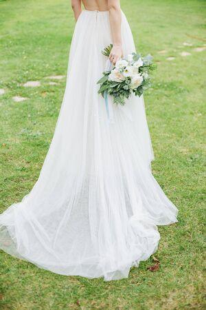 bride beauty dress wedding outside flowers bouquet garden grass lawn summer