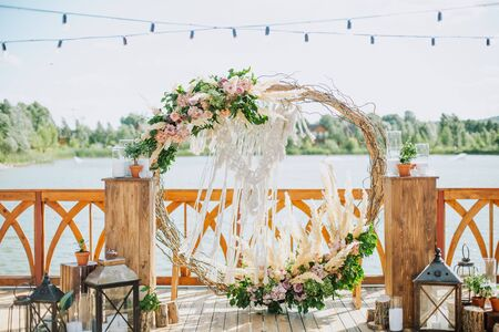 wedding decor flowers postcard venue of the ceremony outside riverbank without people